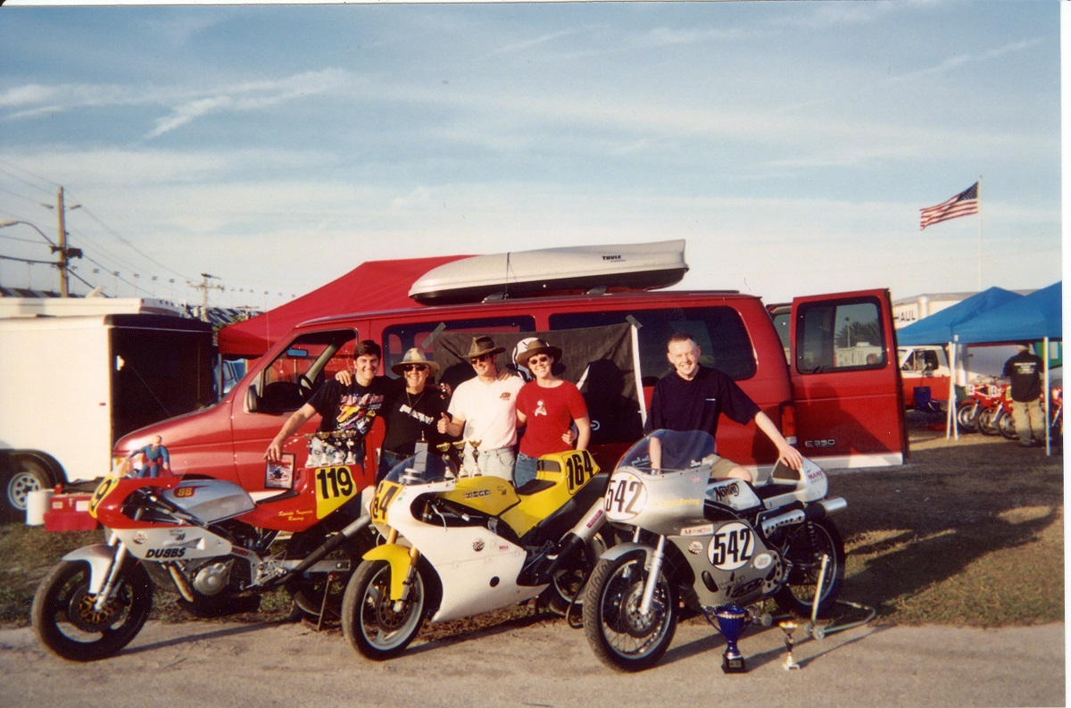 Team with Bikes and Trophies 2 1200.jpg